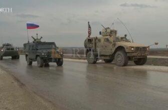 Колонна российских десантников проезжает пост армии США
