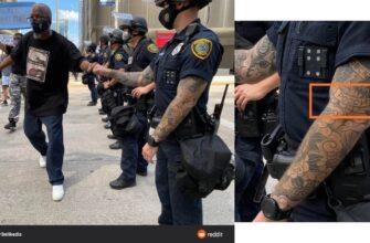 Американский полицейский с татуировкой «Россия»